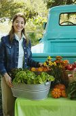Middle Eastern women at organic farm stand