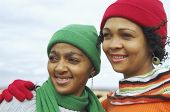 African women wearing winter hats and scarves