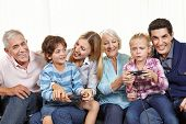 Happy family with controller playing video games on Smart TV in living room