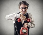 Man holding an old fashioned phone