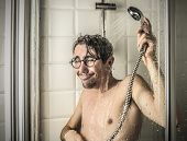 Funny man under the shower