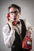 Man holding a red phone