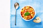 picture of pangasius  - chickpeas with vegetables and pangasius on a light blue background - JPG