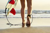 image of board-walk  - Young beautiful surfer girl on beach with surf board at day break - JPG