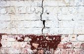 Cracked Whitewashed Brick Wall