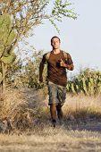Hispanic man jogging with backpack