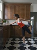 picture of pacific islander ethnicity  - Pacific Islander woman stretching - JPG