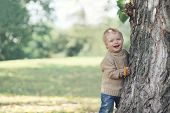 Positive Child Having Fun In Warm Autumn Day, Copy Space