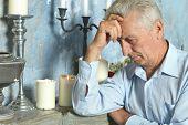 Pensive elderly man
