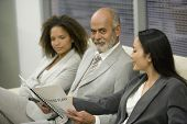 Multi-ethnic businesspeople looking at paperwork