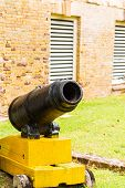 Small Cannon On Yellow Stand
