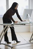 Asian businesswoman looking at computer