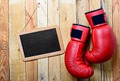 Pair Of Red Boxing Gloves With A Chalkboard