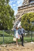 Young Couple Near The Eiffel Tower