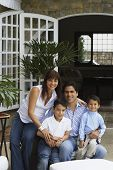 pic of adoration  - Hispanic family sitting on patio - JPG