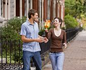 Hispanic woman giving gift to boyfriend