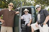 Hispanic men in sunglasses next to truck