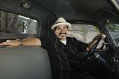 Hispanic man sitting in truck