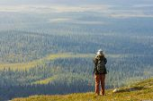 foto of laplander  - Young woman on a top of hill in Lapland - JPG