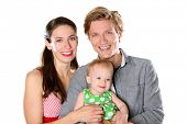 Loving young family on a white background