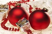 Two red Christmas baubles