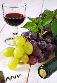 Red And Green Grapes, Bottle, Corkscrew And Glass Of Red Wine