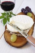 French Goat Cheese, Grapes And Glass Of Red Wine
