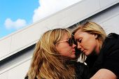 picture of flirt  - two beautiful women flirting in the sunshine - JPG