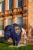 Painted statue of Buffalo in front of Council Hall building