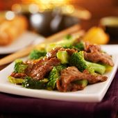 image of stir fry  - chinese beef and broccoli  stir fry in warm light - JPG