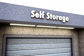 stock photo of self-storage  - Illustration of a self storage sign on concrete surface - JPG