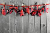 Fabric Christmas ornament hanging on wooden background