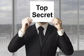 Businessman Hiding Face Behind Sign Top Secret