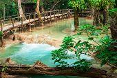 Tropical Rain Forest Jungle With Kuang Si Cascade Waterfall. Luang Prabang, Laos