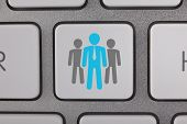 Business Blue People on Computer Keyboard