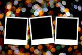 Blank photo frame on colorful christmas
