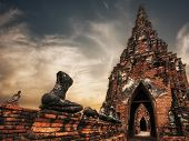 Ancient Buddhist pagoda ruins at Chai Watthanaram temple under sunset sky. Ayutthaya Thailand