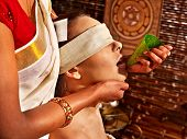Woman having nose ayurveda spa treatment.