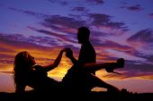 Woman Lay Down Silhouette With Man Hold Hands