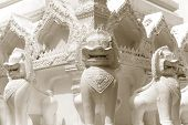 picture of guardian  - Lion guardian statues in Buddhism Temple around Pagoda vintage tone in Bangkok Thailand - JPG