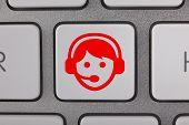 Service on Keyboard Red Man