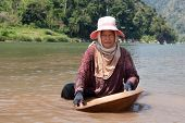 image of ou  - woman washing gold in river portrait of asian at nam ou in Laos - JPG