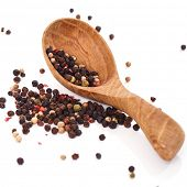 Peppercorn with a spoon on a white background