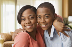 picture of pre-adolescents  - African mother hugging son - JPG