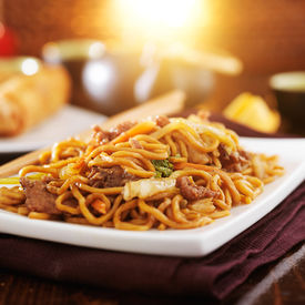 image of lo mein  - chinese beef lo mein with orange glow in background - JPG