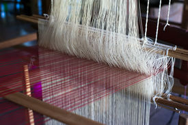 foto of handloom  - Vintage manual weaving loom with unfinished textile work - JPG