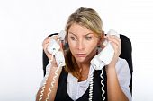 pic of frazzled  - an overworked secretary trying to answer alot of telephones - JPG
