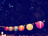 Chinese Paper Lanterns at a party during the evening toned with a retro vintage instagram filter app or action