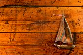 Copper Sailboat On Textured Wood