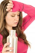 Exhausted Female Fitness Model Holding A Stainless Steel Water Bottle